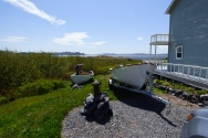 Reusing an old boat, next to the new boat, in Tickle Cove, NL